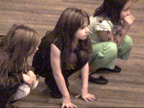 Maggie as a mouse in rehearsal